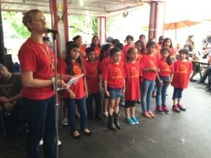 The Perez Elementary School Choir, with Faith Cuminato, delights the audience.